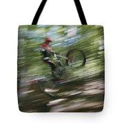 A Boy Flies Through The Air Tote Bag