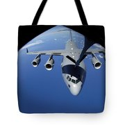 A C-17 Globemaster IIi Receives Fuel Tote Bag by Stocktrek Images