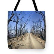 A Dirt Road Runs Along A Mountain Top Tote Bag