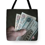 A Hand Holds Egyptian Pounds In Cash Tote Bag