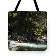 A Kayaker Paddles In A Rapid As Seen Tote Bag
