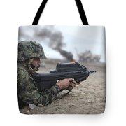A Peruvian Marine Assaults A Beach Tote Bag