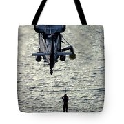 A Search And Rescue Swimmer Is Hoisted Tote Bag