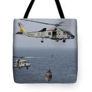 A Sh-60j Seahawk Transfers Cargo Tote Bag