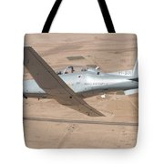 A T-6 Texan Flying Over Camp Speicher Tote Bag