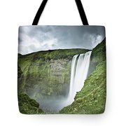A Waterfall Over A Grassy Cliff Tote Bag