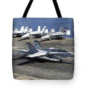An Fa-18e Super Hornet Lands Aboard Tote Bag