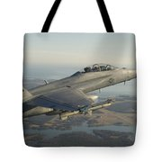 An Fa-18f Super Hornet Armed With An Tote Bag