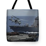 An Mh-60s Knighthawk Helicopter Tote Bag