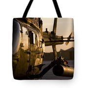 An Oh-58d Kiowa During Sunset Tote Bag