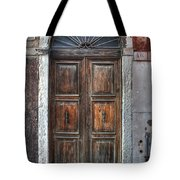 an old wooden door in Italy Tote Bag by Joana Kruse