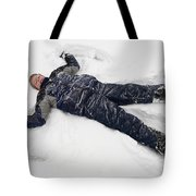 Boy And Snow Angel Tote Bag