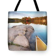 Canoe At A Rocky Shore Autumn Nature Scenery Tote Bag