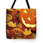 Carved Pumpkin On Fallen Leaves Tote Bag