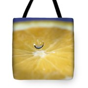 Drip Over An Orange Tote Bag