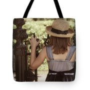 Girl Looking Over Iron Gate Tote Bag