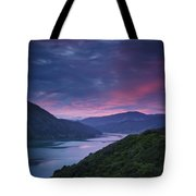 Mountains Along The Coastline Under A Tote Bag