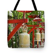 Row Of Bells In A Temple Covered By Red Umbrella Tote Bag