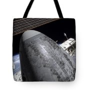 Space Shuttle Discovery Docked Tote Bag