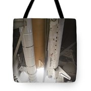 Space Shuttle Discovery Lifts Tote Bag