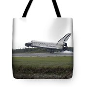 Space Shuttle Discovery Touches Tote Bag