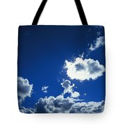 Sunlit Fluffy White Clouds In A Blue Tote Bag