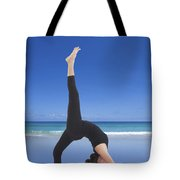 Woman Doing Yoga On The Beach Tote Bag by Setsiri Silapasuwanchai