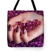 Woman Hand With Purple Nail Polish On Candy Tote Bag