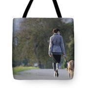 Woman Walking With Her Dogs Tote Bag