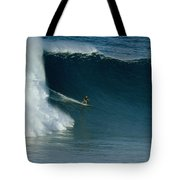A Surfer Rides A Powerful Wave Tote Bag
