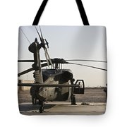 A Uh-60 Black Hawk Helicopter Parked Tote Bag