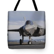 An Aviation Boatswains Mate Directs An Tote Bag