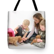 Family With Cockerpoo Pups Tote Bag