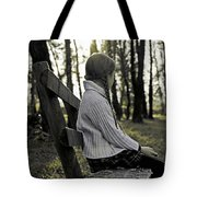 Girl Sitting On A Wooden Bench In The Forest Against The Light Tote Bag