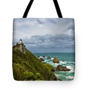 Nugget Point Light House And Dark Clouds In The Sky Tote Bag