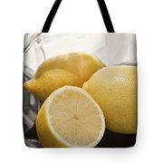 Still Life Of Bottles  And Lemons Tote Bag