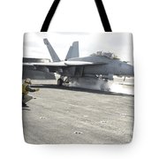 An Fa-18f Super Hornet Launches Tote Bag