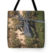 An Ah-64d Apache Helicopter In Flight Tote Bag