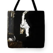 Astronaut Working On The Hubble Space Tote Bag
