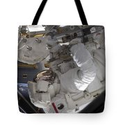 Astronaut Working On The International Tote Bag