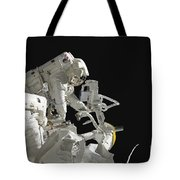Astronauts Working On The International Tote Bag