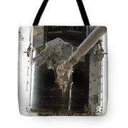 Astronauts Working On The Hubble Space Tote Bag