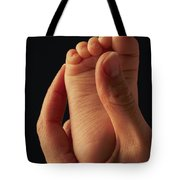 A Babys Foot In An Adult Hand Tote Bag
