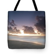 A Beach During Misty Sunset With Glowing Sky Tote Bag