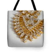 A Beautiful Gold And Diamond Pendant On A White Background Tote Bag