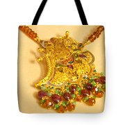 A Beautiful Intricately Carved Gold Pendant Hanging From A Semi-precious Stone Chain Tote Bag
