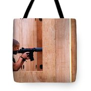 A Belgian Soldier Trying Out A Shooting Tote Bag by Luc De Jaeger