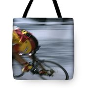 A Bicyclist Speeds Past In A Race Tote Bag