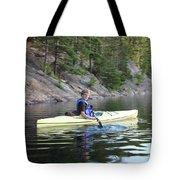 A Boy Kayaking Tote Bag