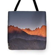 A Building On A Rock Ledge With Tote Bag